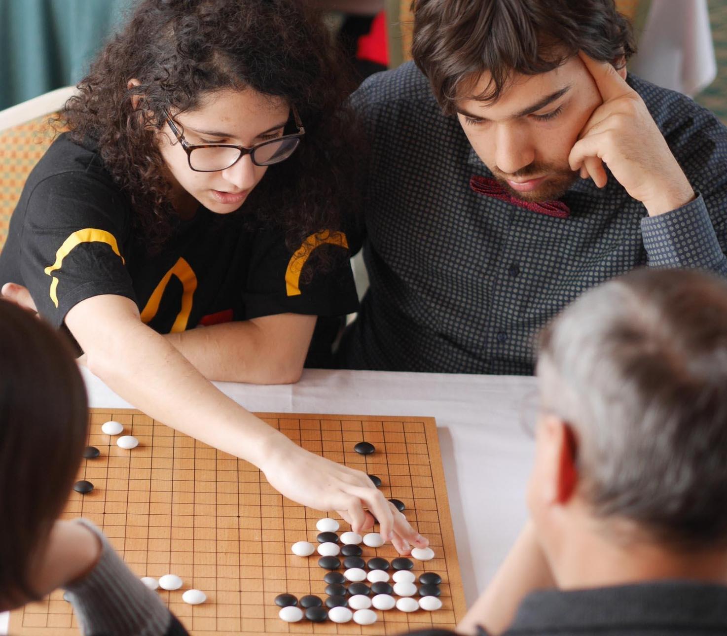 Pair Go - Team Variant of Go Game